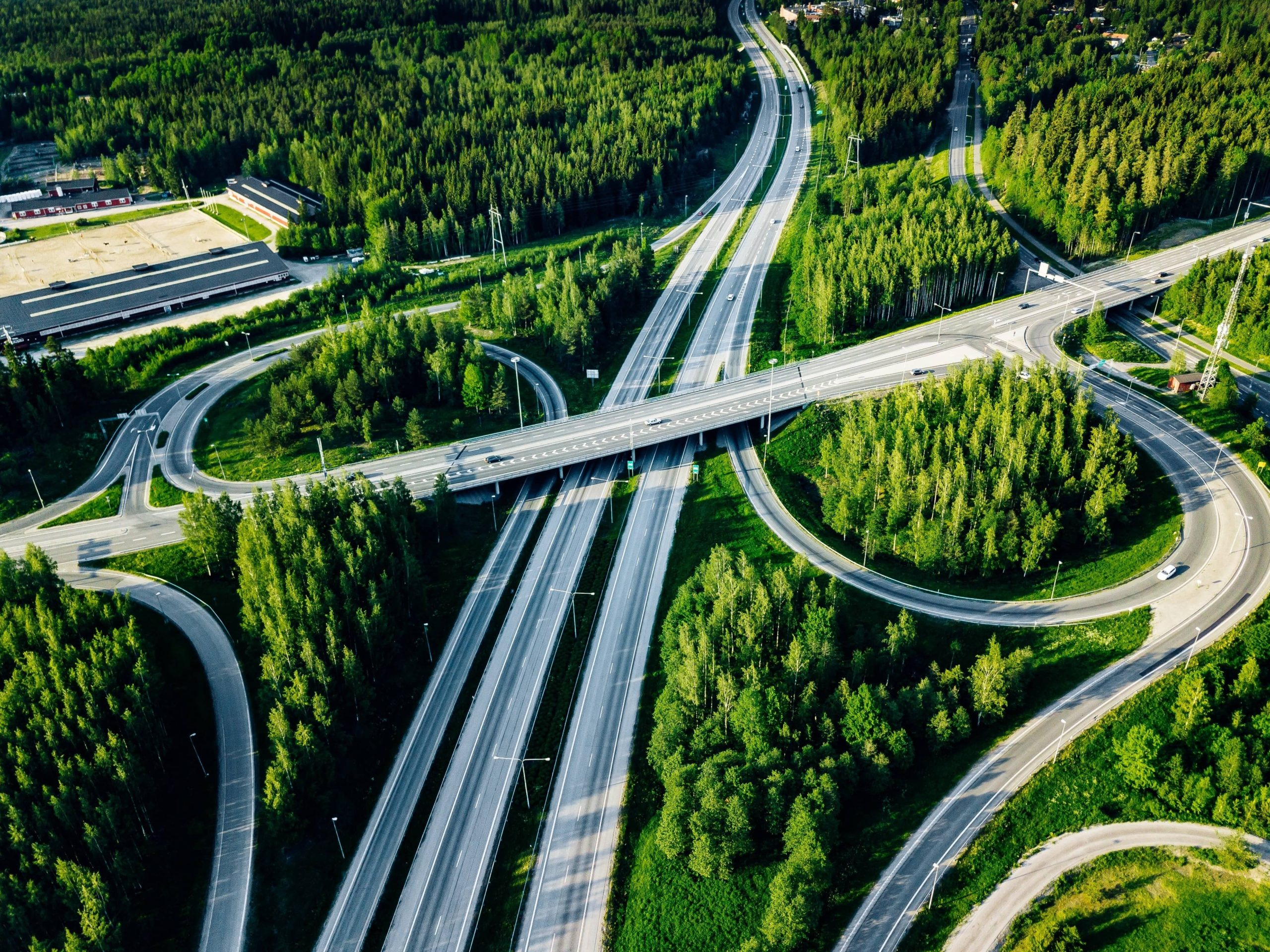 aerial-view-of-highway-and-overpass-with-green-woo-HLC5WBA-1-scaled.jpg